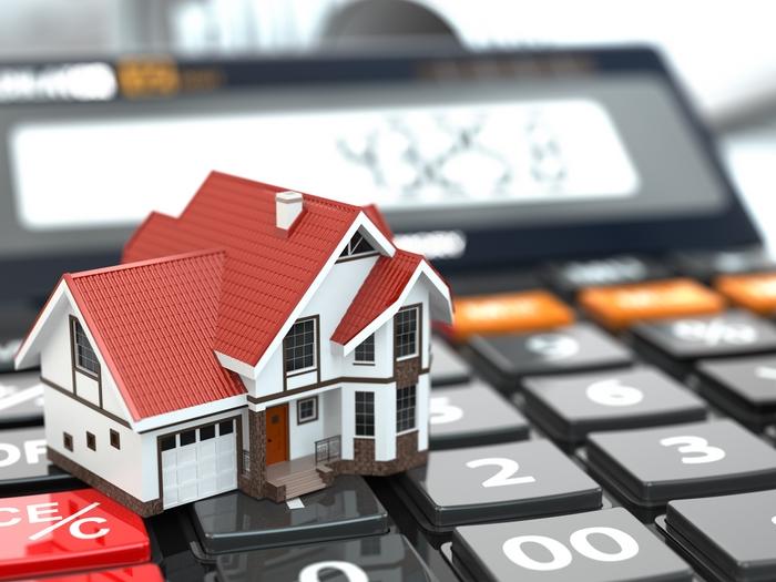 Как рассчитать стоимость налога на недвижимость